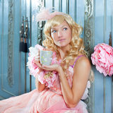 Blond fashion princess woman drinking tea. Or coffee at home with vintage pink dress Royalty Free Stock Photography