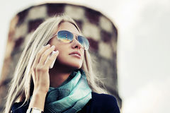 Blond fashion woman calling on the cell phone Royalty Free Stock Images