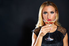 Blond fashion woman drinking vermout cup Stock Photos