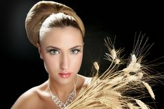 Blond fashion woman holding wheat spike Royalty Free Stock Images