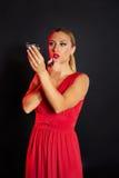 Blond fashion woman lipstick makeup on  mirror Royalty Free Stock Photography