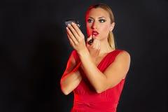 Blond fashion woman lipstick makeup on  mirror Stock Image