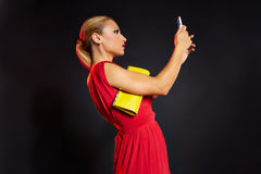 Blond fashion woman selfie photo in smartphone Royalty Free Stock Image