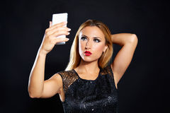 Blond fashion woman smartphone selfie Royalty Free Stock Photography
