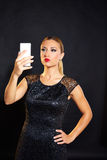 Blond fashion woman smartphone selfie. In black background stock photos