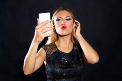 Blond fashion woman smartphone selfie Stock Image