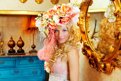 Blond fashion woman with spring flowers hat Stock Photo