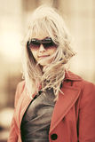 Blond fashion woman in sunglasses on city street Royalty Free Stock Photography