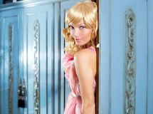 Blond fashion woman vintage in wardrobe pink dress royalty free stock photo