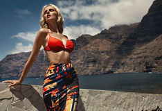 Blond fashionable woman wearing a fancy swimmsuit Stock Photo