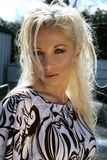 Blond female. Pretty blond fashion model posing outdoors in the summer Stock Photography
