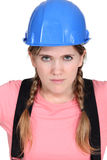 Blond female builder. With serious expression on face Stock Image