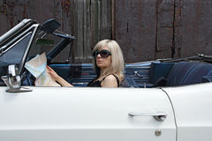 Blond female in convertible car Royalty Free Stock Photography