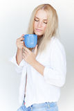 Blond female with cup of tea Royalty Free Stock Photos