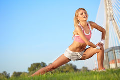 Blond female fitness model Stock Photography