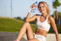 Blond female fitness model Royalty Free Stock Image