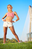 Blond female fitness model Stock Photos