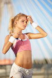 Blond female fitness model Royalty Free Stock Photo