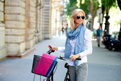 Blond female going to work by cycle Stock Photo