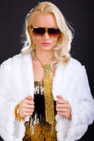 Blond female in gold sunglasses Royalty Free Stock Image