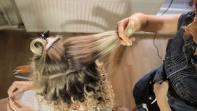 Blond Female In Hair Salon. Hairdresser On Background stock footage