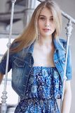 Blond  female in jeans jacket. Attractive young blond  female in jeans jacket Stock Image