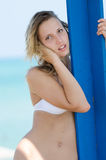 Blond female model with slim and attractive body in bikini Stock Images