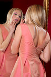 Blond female in pink dress l Royalty Free Stock Images