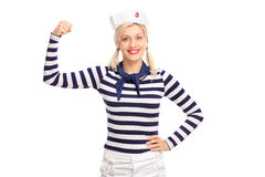 Blond female sailor showing her bicep Stock Image