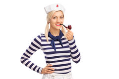 Blond female sailor smoking a pipe Stock Images