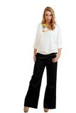 Blond female teenager wearing black pants and whit Stock Images