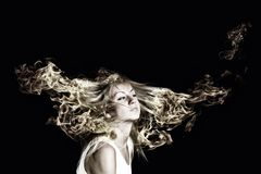 Blond in fire Royalty Free Stock Photography