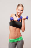 Blond fitness girl. Royalty Free Stock Photography