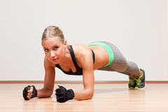 Blond fitness girl. Royalty Free Stock Images