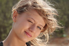 Blond fitness girl in wind portrait - blinking Stock Photography