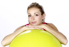 Blond fitness sport girl with ball Stock Photography