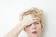 Allvarligt problem - huvudvärk Royaltyfri Fotografi