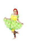 Blond flicka i den felika karnevaldräkten som isoleras på vit Royaltyfria Foton