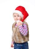 blond flicka i ett pälsomslag och en röda Santas lock Arkivbild