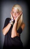 Blond flickanågot att säga oh min gud royaltyfri foto
