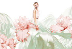 Blond in flying dress with flowers Stock Photo