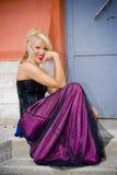 blond formell kappakvinna royaltyfria bilder