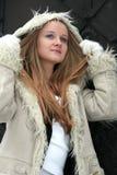 Blond freckled girl in fur coat Stock Photo