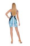 Blond geïsoleerd haarmeisje in mini blauwe kleding Stock Foto's