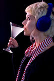 Blond girl. Young blond girl drinking cocktail and staring-up Royalty Free Stock Photos