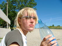 Blond girl. Holding a water-bottle Royalty Free Stock Images