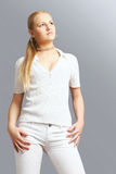 Blond girl. A blond girl in white clothes Stock Images