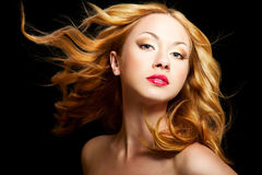 Blond girl. Beautiful blond woman with long curly hair Stock Photos