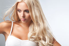 Blond Girl. Portrait of beautiful blonde woman . Healthy Long Blond Hair. Hair Extension Stock Images