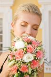 Blond girl. With a bouquet of roses Stock Images